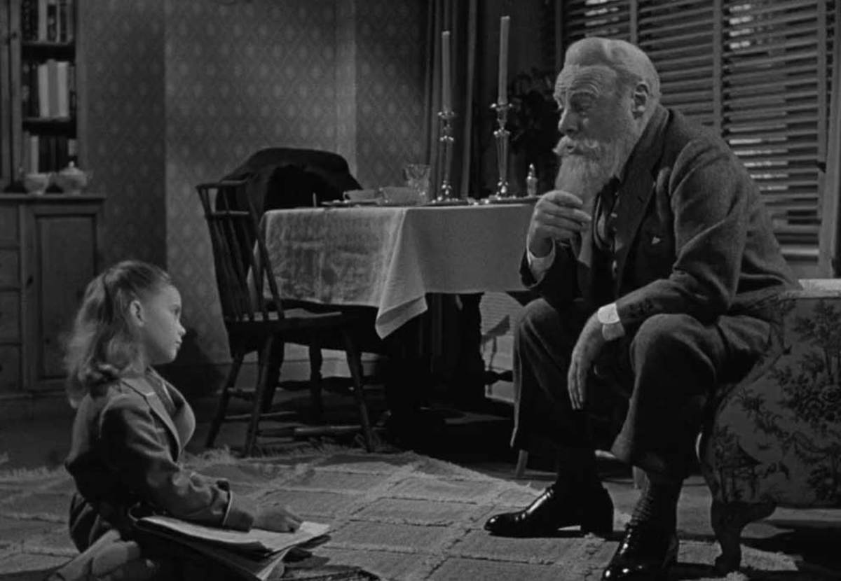 The relationship between Wood (left) and Gwenn (right) feels natural and underscores Gwenn's perfect portrayal of Kris Kringle.