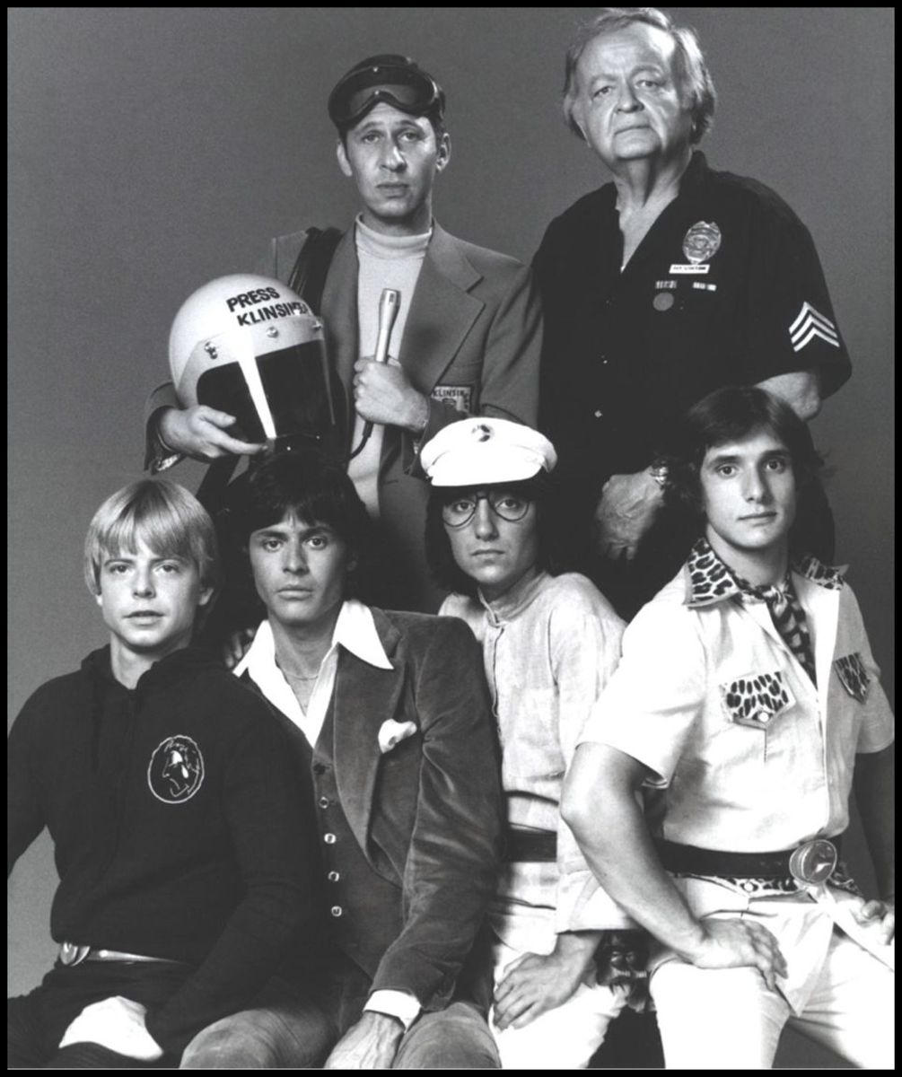 A cast publicity photo of The Kids From C.A.P.E.R.  Top Row: Left to right:Robert Lussier and Robert Emhardt Bottom Row:Left to right: Biff Warren, John Lansing, Cosie Costa and Steve Bonino