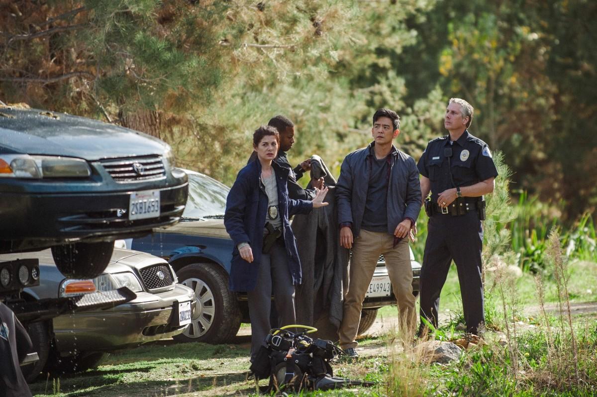"Debra Messing and John Cho as Detective Vick and David Kim in, ""Searching."""