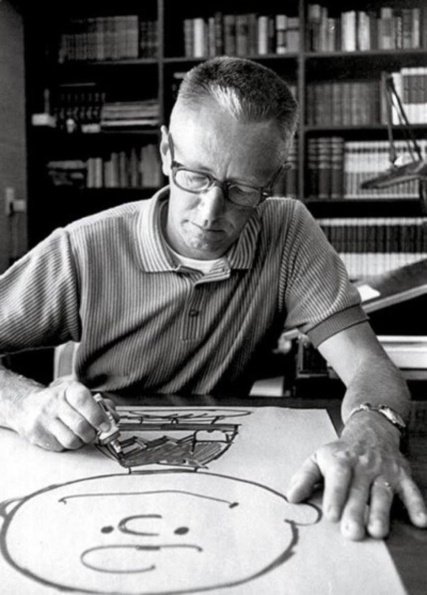 Charles Schultz drawing comic strip
