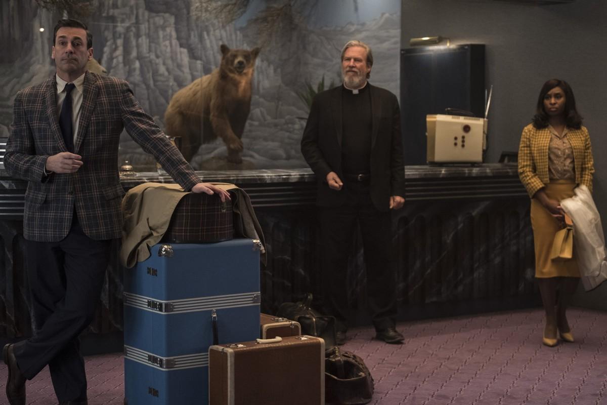 "Jon Hamm, Jeff Bridges, and Cynthia Eriva as Seymour 'Laramie' Sullivan, Father Daniel Flynn, and Darlene Sweet in, ""Bad Times at the El Royale."""