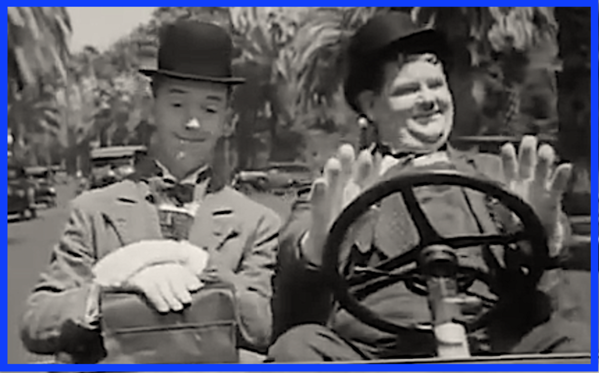 "Laurel and Hardy in scene from ""Busy Bodies."""