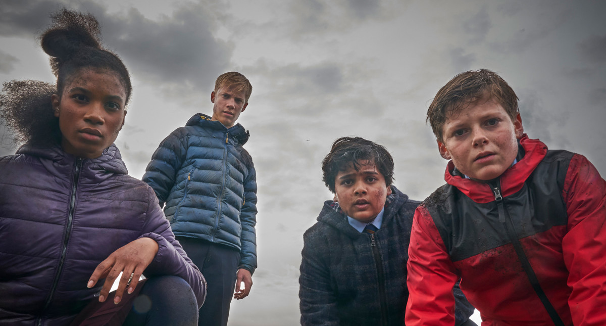 "From left to right: Kaye (Rhianna Doris), Lance (Tom Taylor), Bedders (Dean Chaumoo), and Alex (Louis Ashburne Serkis) in, ""The Kid Who Would Be King."""