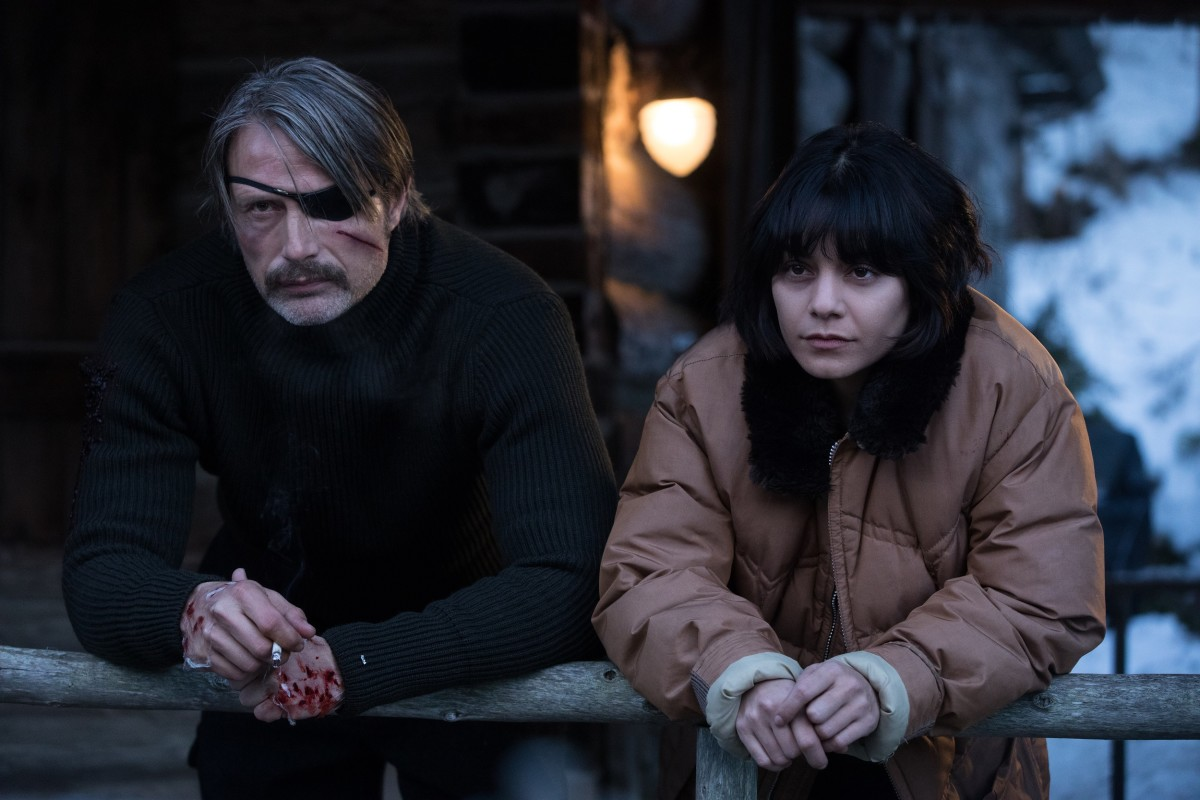 "Mads Mikkelsen and Vanessa Hudgens as Duncan Vizla and Camille in, ""Polar."""