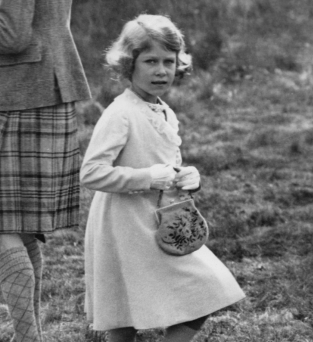 Queen Elizabeth carrying a handbag at seven years old in 1933