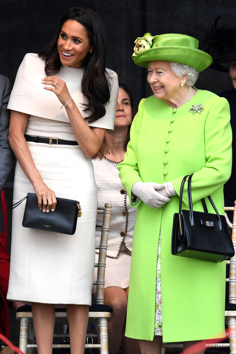 The Duchess of Sussex carries a clutch. Queen Elizabeth is seen with her iconic handbag.