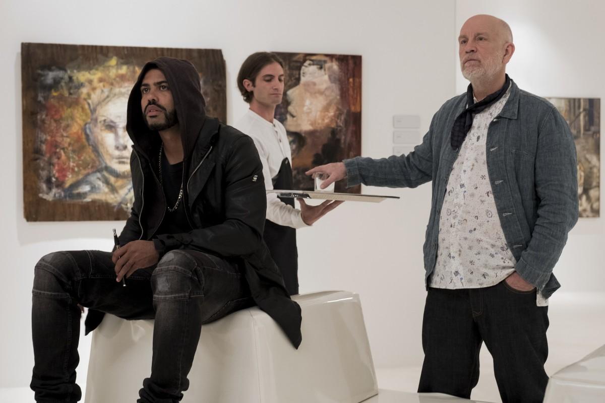 "Daveed Diggs and John Malkovich as artists Damrish and Piers in, ""Velvet Buzzsaw."""