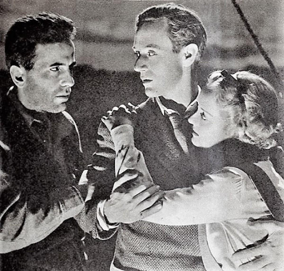 """Humphrey Bogart, Leslie Howard, and Bette Davis in """"The Petrified Forest"""" screenshot."""