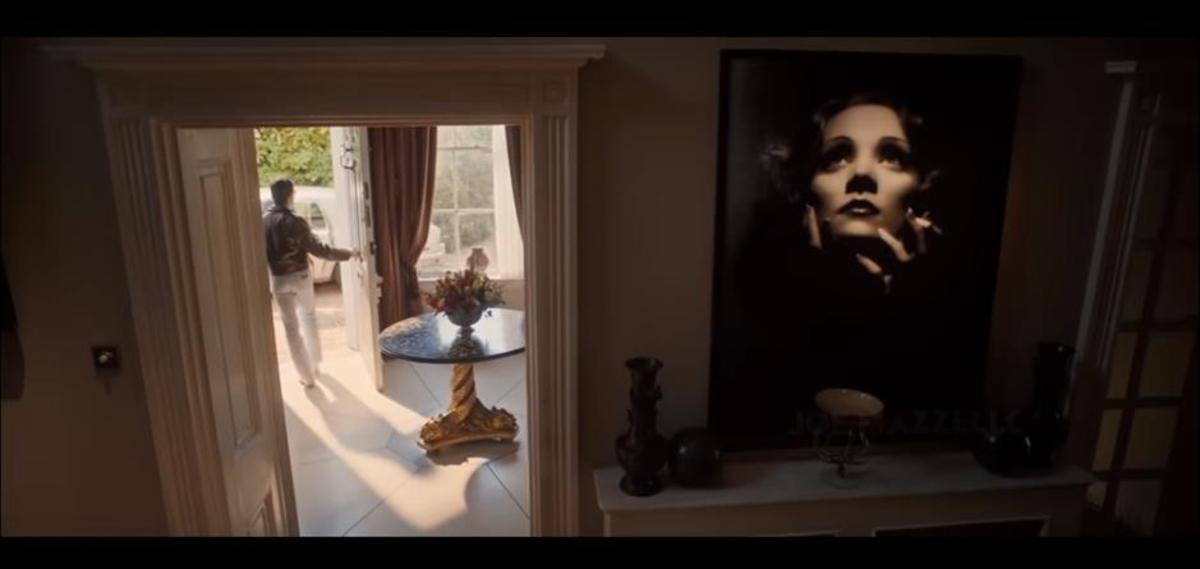 Wide-shot of Freddie's house with focus on  Marlene Dietrich Painting