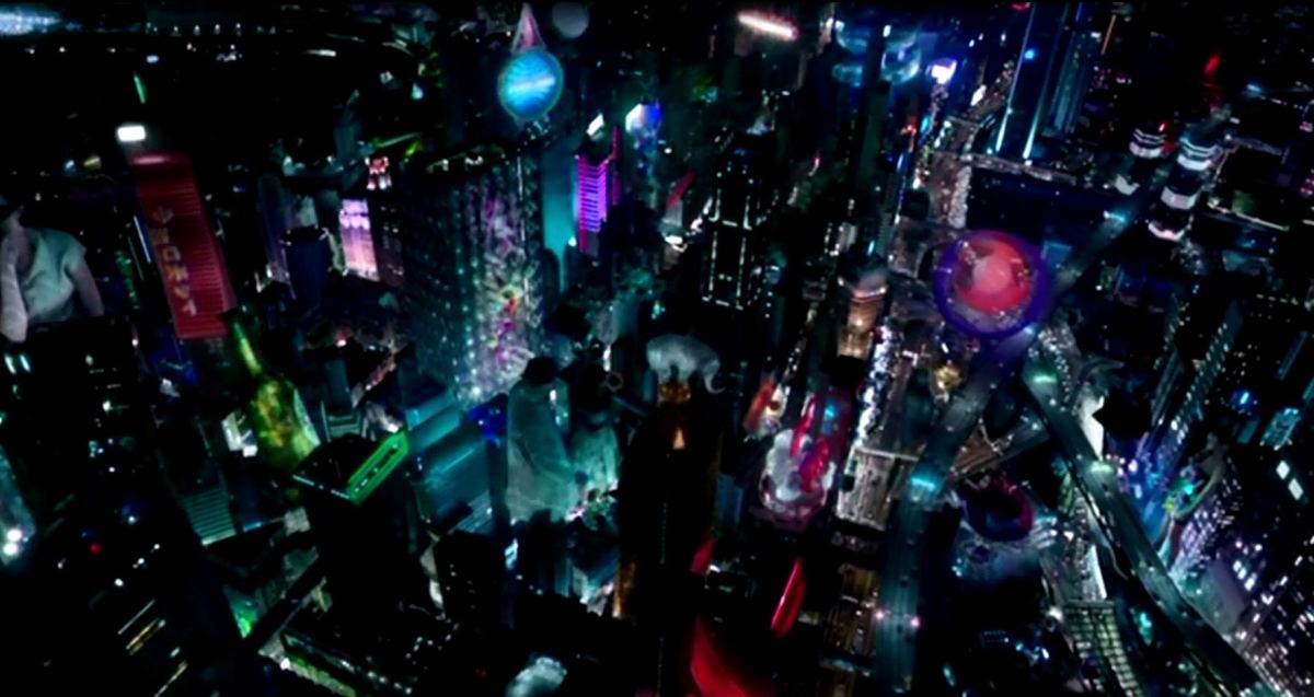Ghost in the Shell is set in a futuristic city, filled with vibrant lights and holographic advertisements.