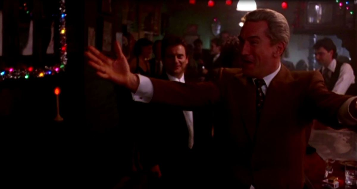 Jimmy Conway celebrates with his friends after making a fortune from the Lufthansa heist.