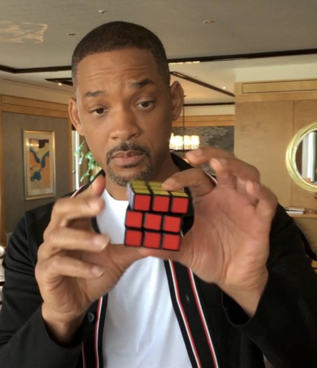Will Smith with a rubik's cube.