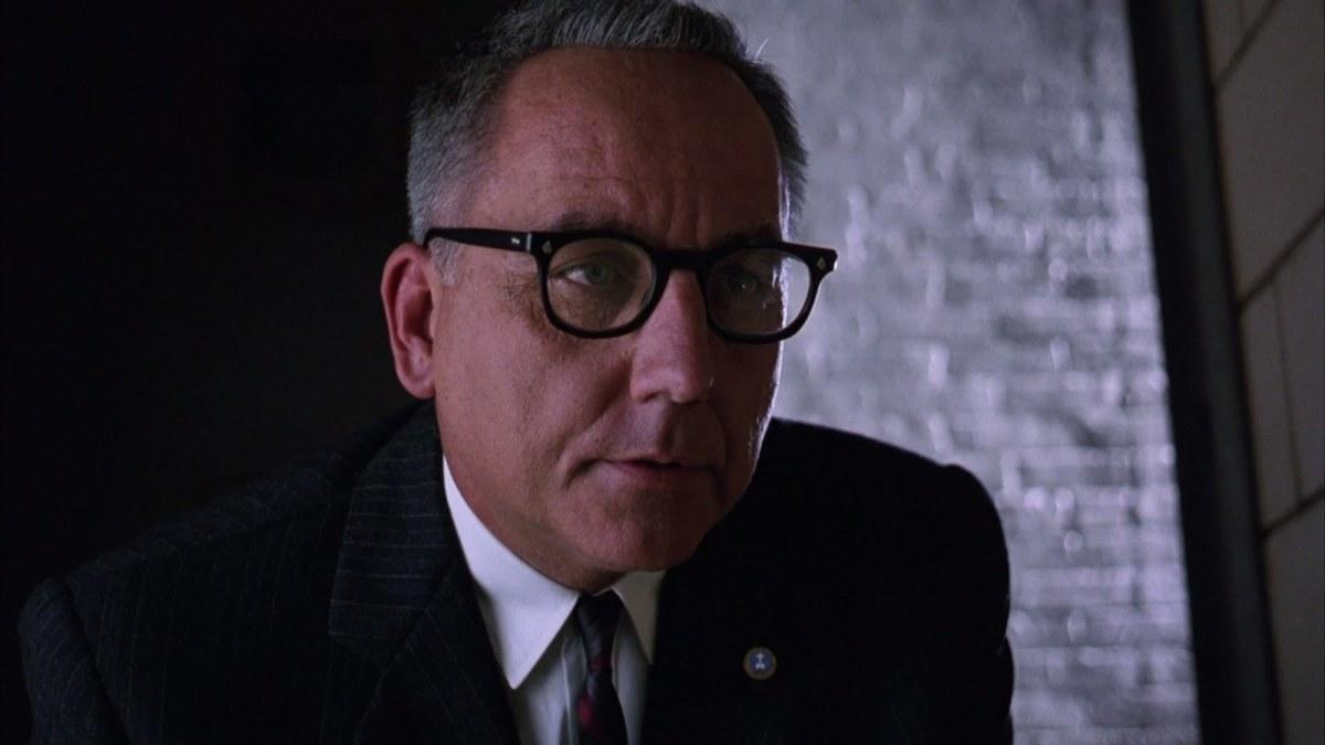 Bob Gunton as Warden Samuel Norton.