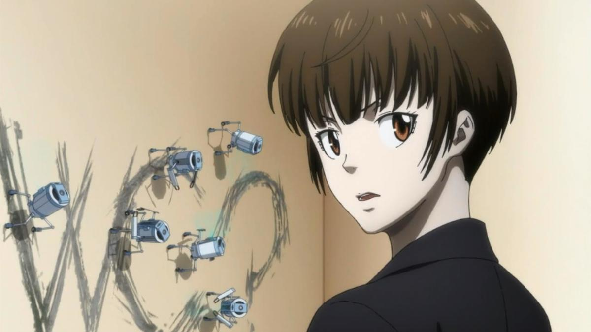 """Akane investigates the writing on the wall; """"WC?"""" - the question that drives the narrative."""