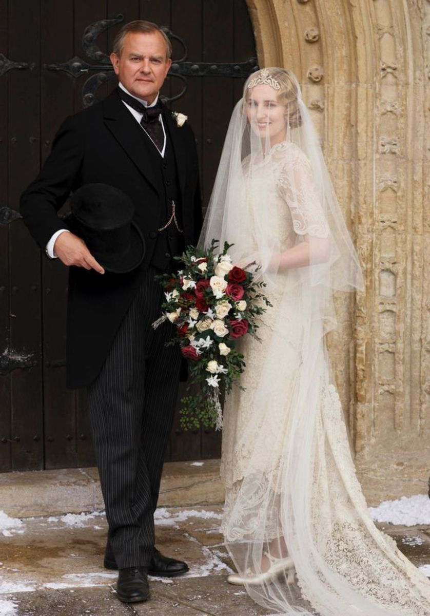 Laura Carmichael as Lady Edith Crawley and Hugh Bonneville as Lord Grantham.