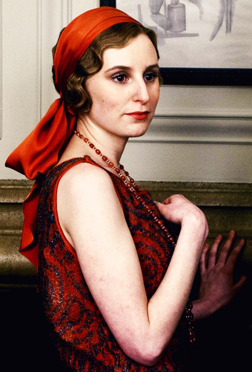 Lady Edith in an orange headscarf.
