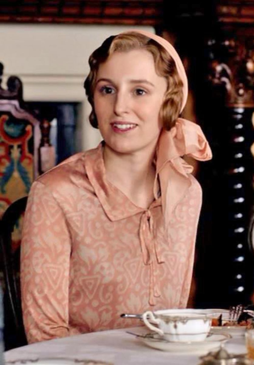 Lady Edith in a pink headscarf.