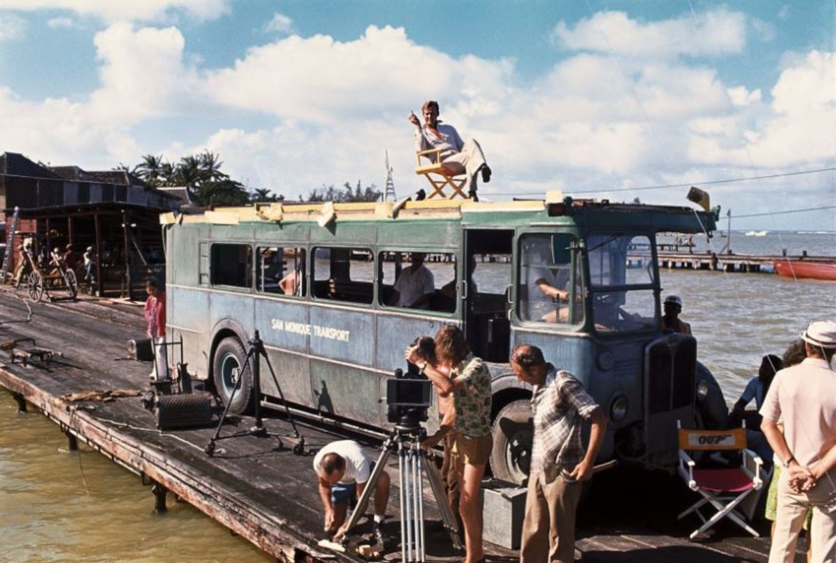 """""""Live and Let Die"""" on the film set Roger Moore seated on the top deck, on Sunday, December 10, 1972."""