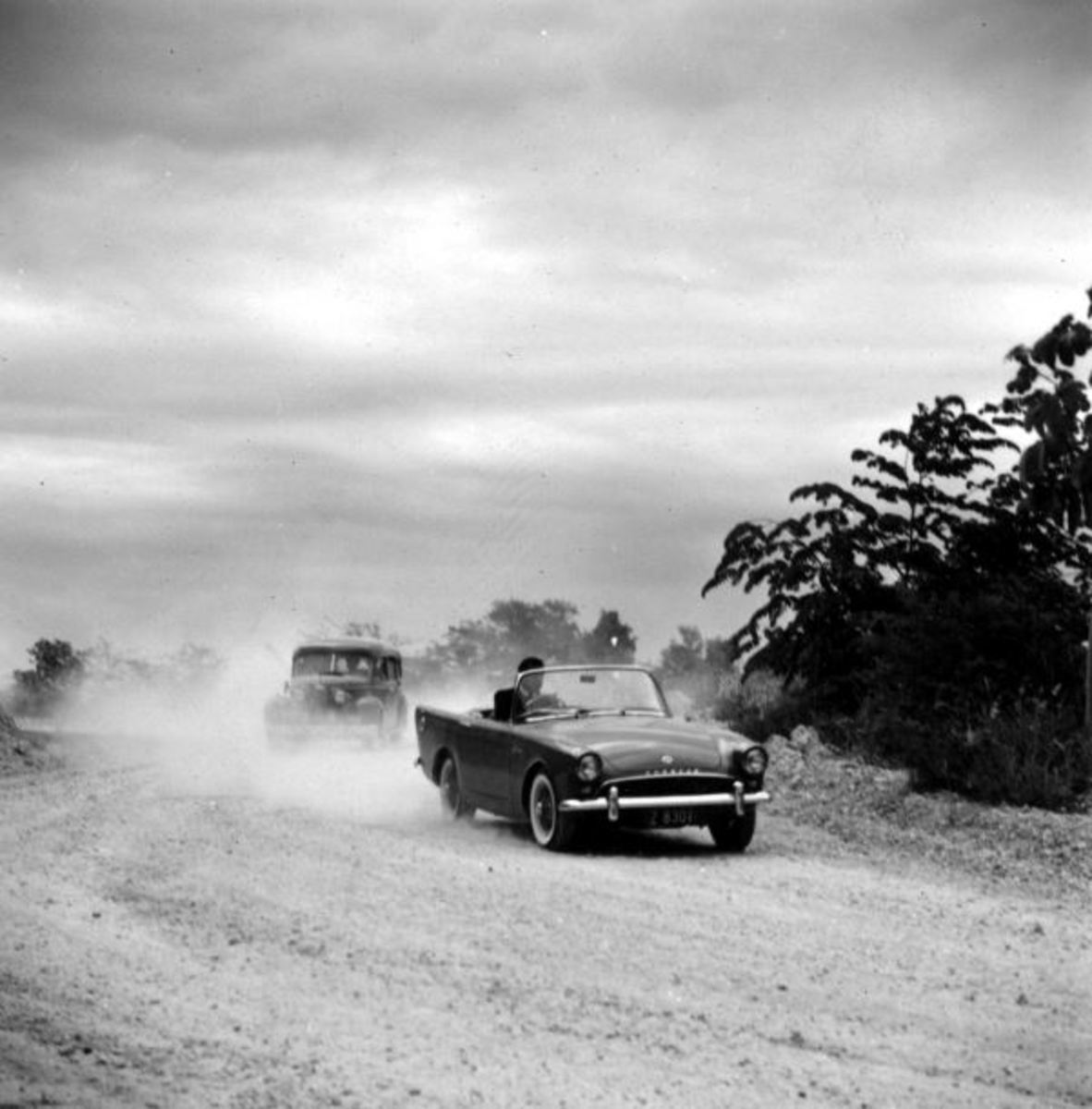 The first James Bond car, Sunbeam Alpine, is driven by Connery while being chased by The Three Blind Mice.