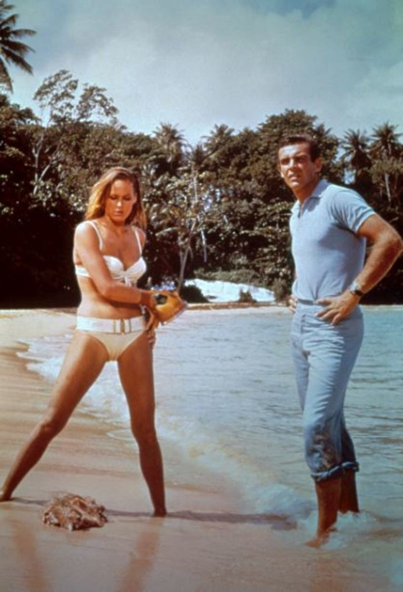 Honey Ryder and 007 are looking down at the beach in Jamaica.
