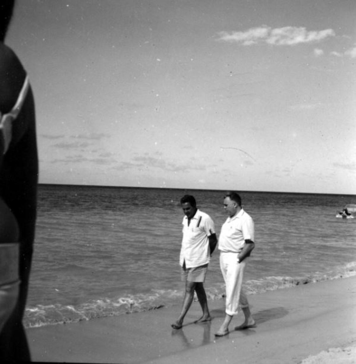 Strolling on the Jamaican beach, Cubby Broccoli and Harry Saltzman are deep in conversation about producing.