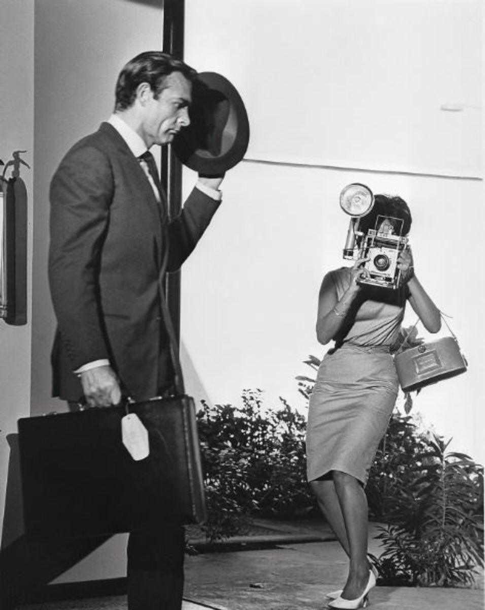Marguerite LeWars plays the photographer and fails to catch Bond on film.