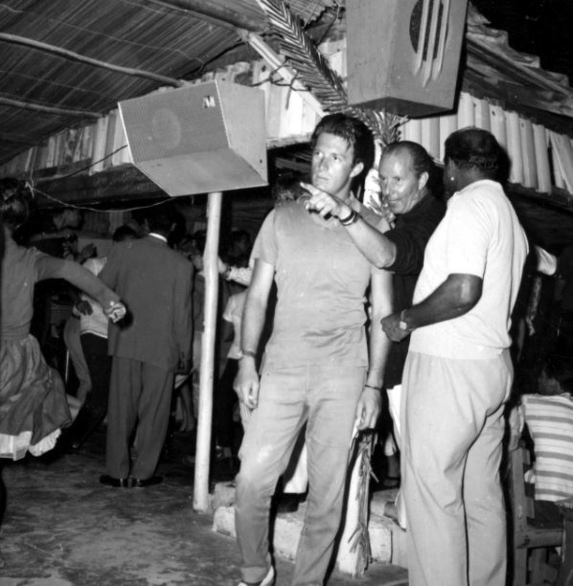 """Chris Blackwell, as the location manager for """"Dr. No,"""" listens to Terence Young."""