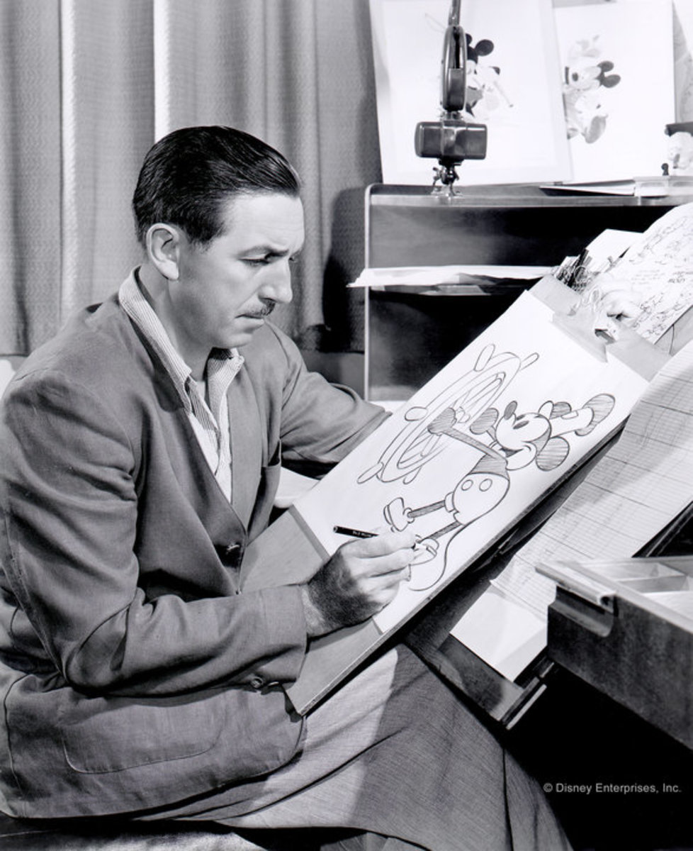 Walt Disney reviewing sketches of Mickey Mouse