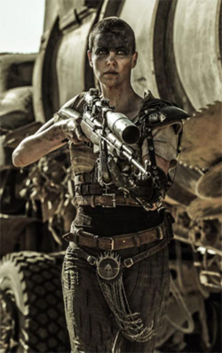 Furiosa aims a gun at an off-screen attacker in a screenshot owned by Warner Bros.