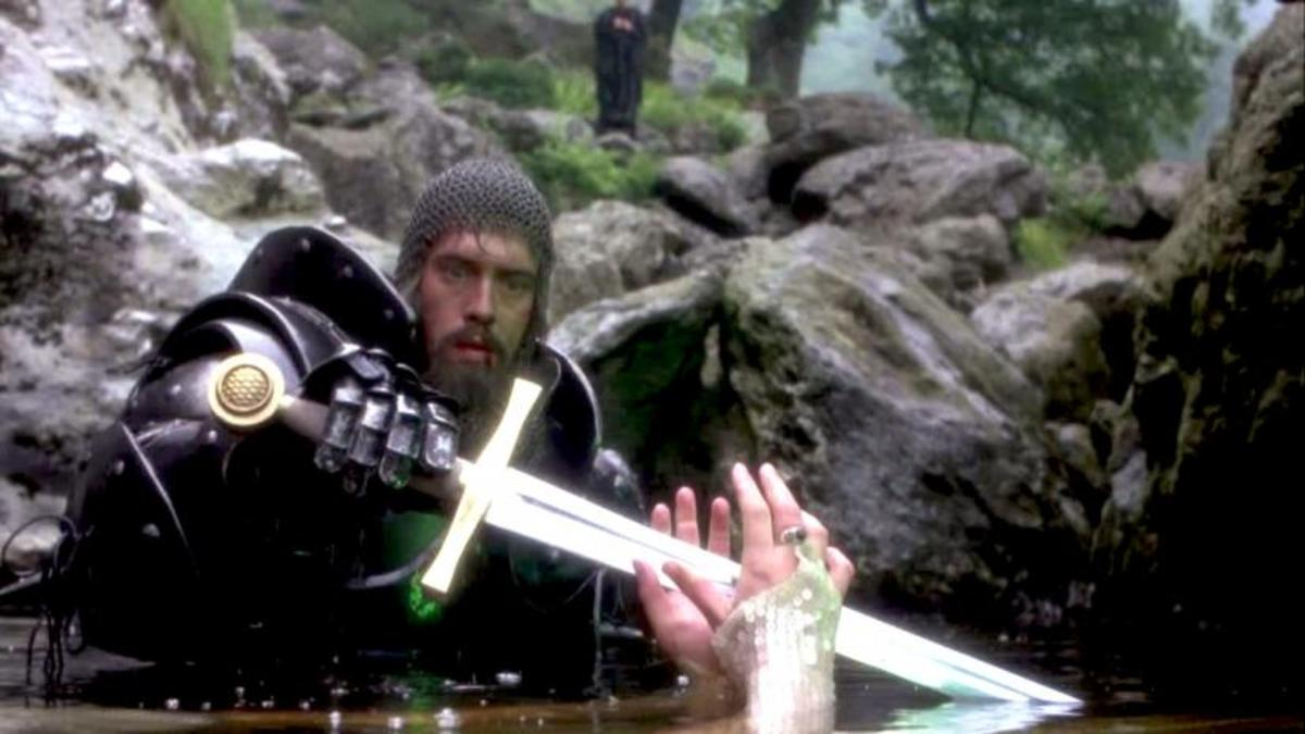 King Arthur (Nigel Terry) reaches for the mended Excalibur from the Lady of the Lake (Hilary Joyalle)