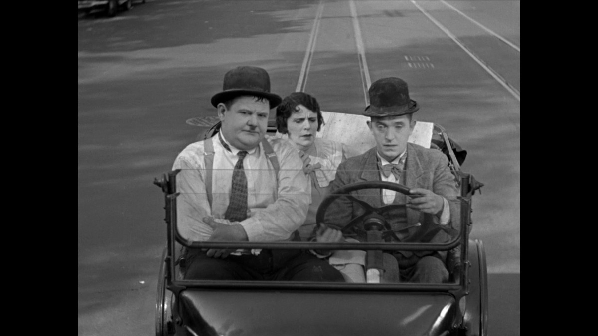 Oliver Hardy, Fay Holderness, and Stan Laurel