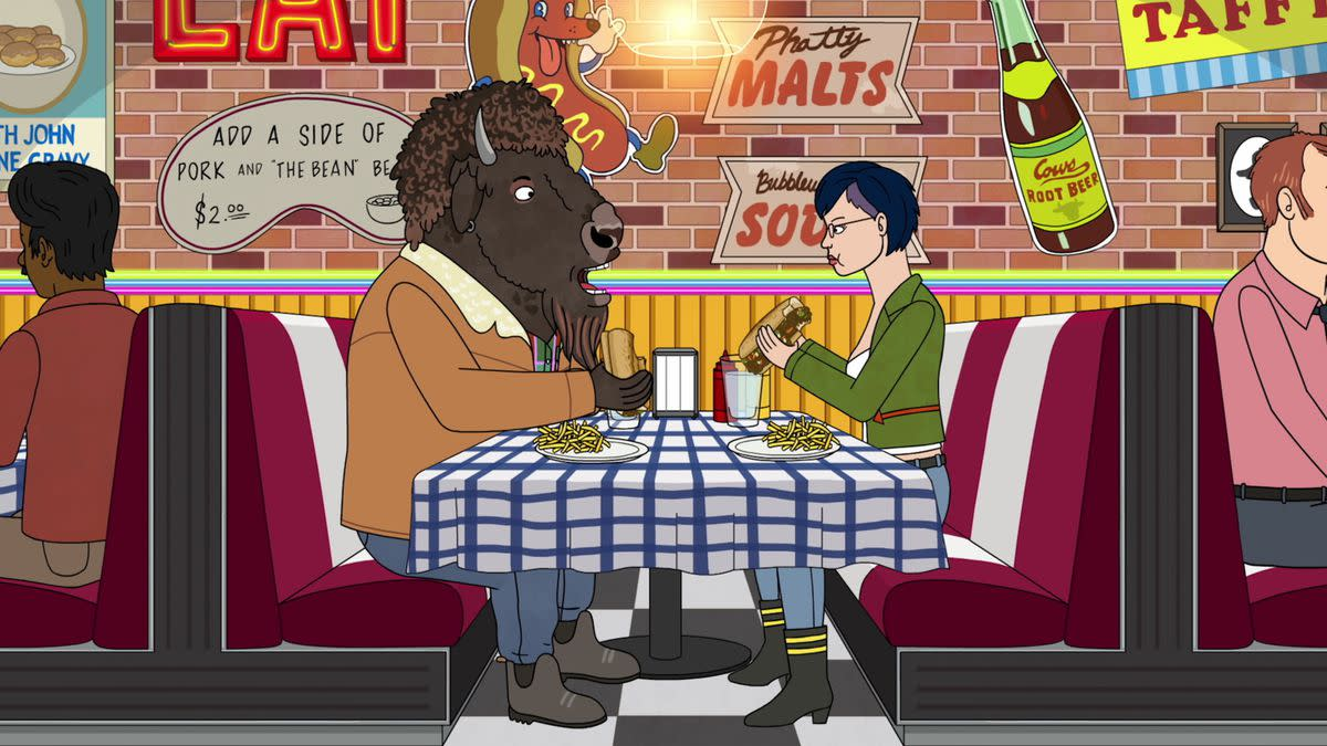 Diane and her boyfriend eat out.