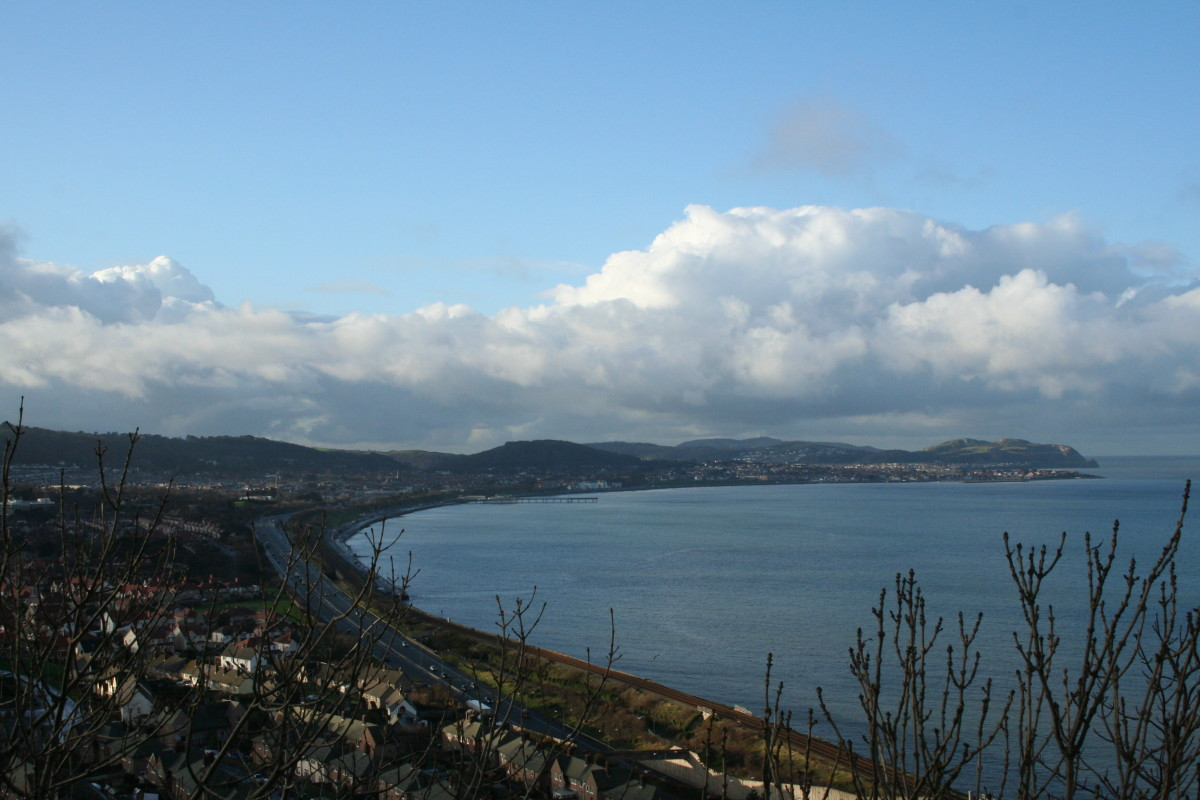 A photo looking out from Old Colwyn—view displays the coastline and town of Colwyn Bay!