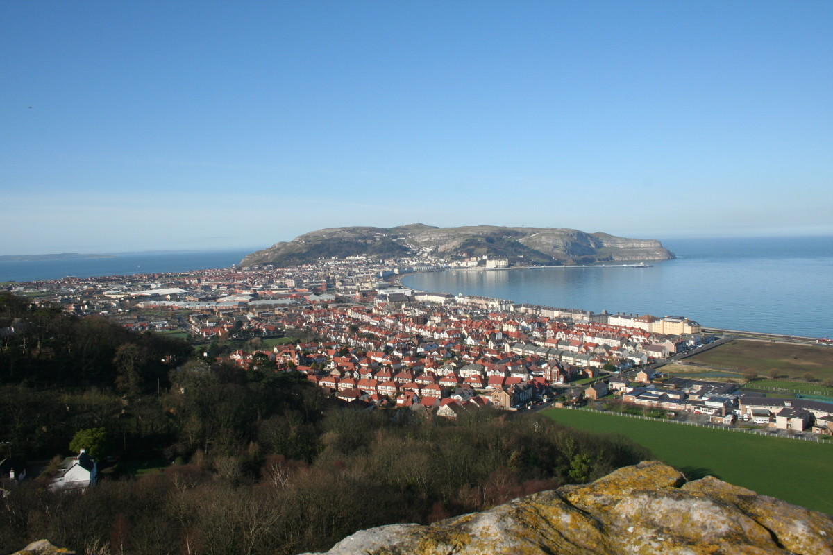 Photo taken from the 'Little Orme' - photo shows the town of Llandudno, it's North and West Short and the mighty Great Orme in the distance.