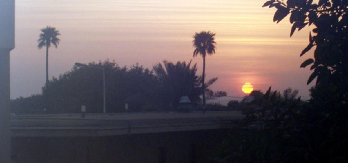 winter sunset over aramco compound, saudi arabia