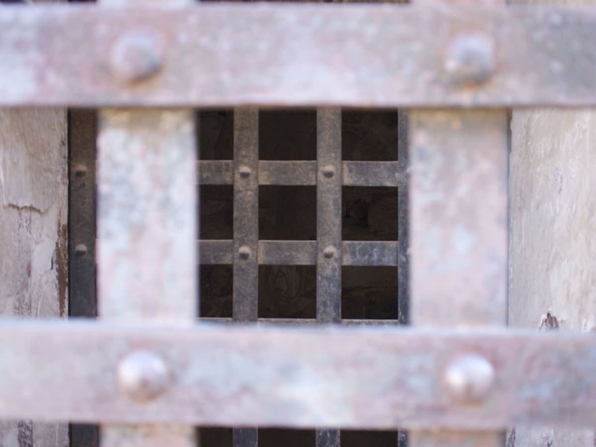 Iron bars of a Yuma Territorial Prison cell with double doors