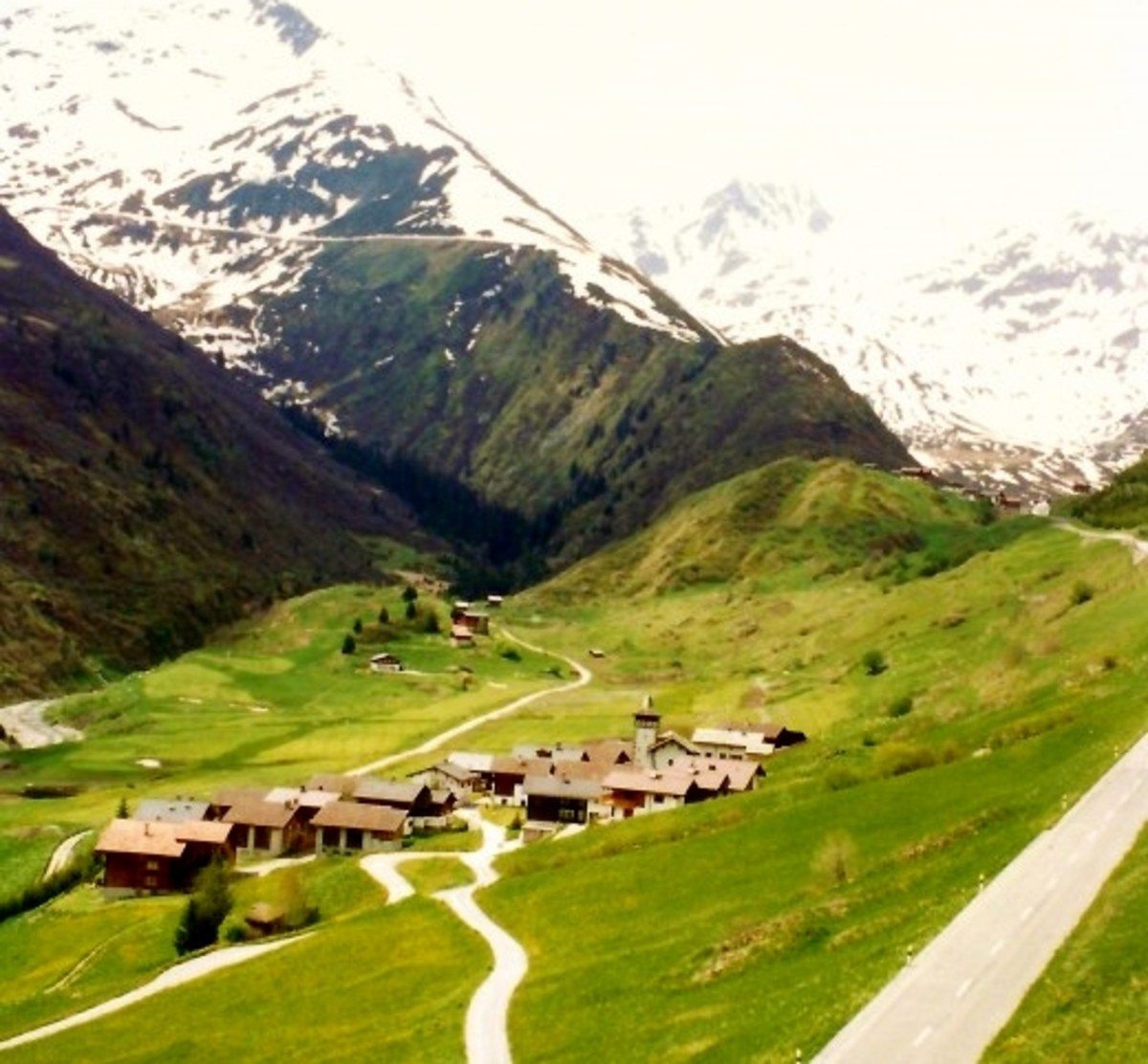 Clusters of homes seen scattered throughout the mountainous region.