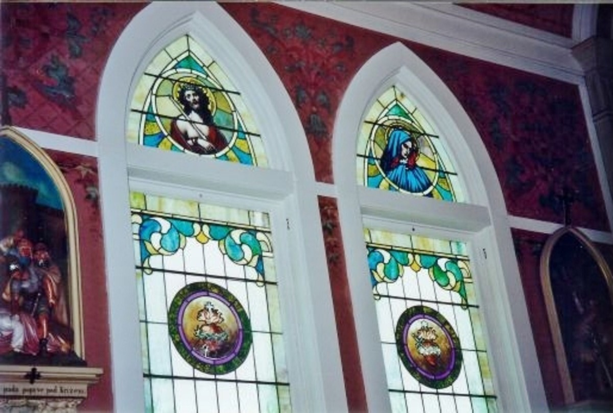 Some of the stained glass windows inside St. John the Baptist Catholic Church.