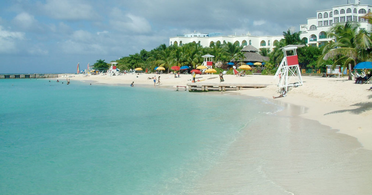 The pure Doctor's Cave beach sits in Montego Bay where most visitors to Jamaica find accommodations.