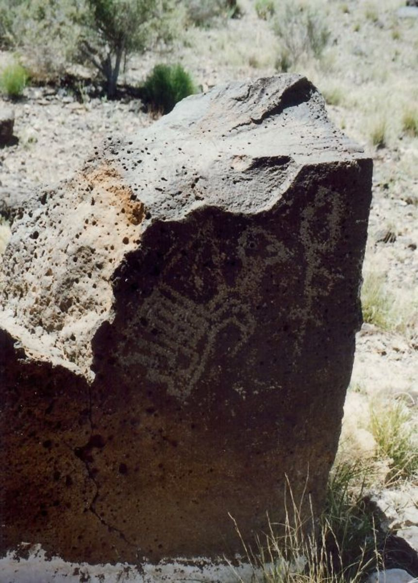 Petroglyphs on the smooth and dark side of this rock.