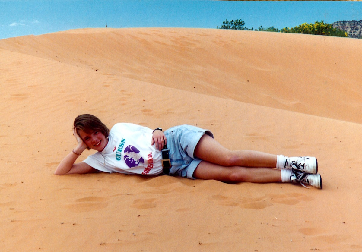 My niece striking a pose on the coral pink sand.