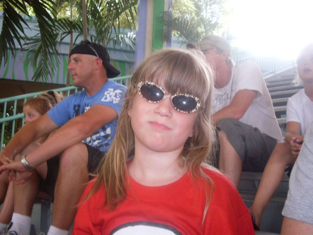 My daughter looking happy as we watch Shamoo at Sea World.