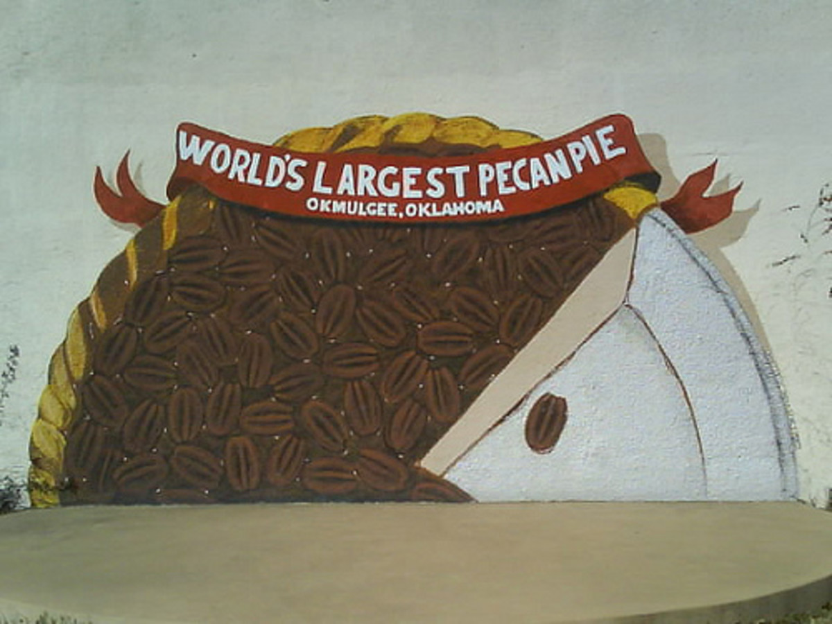 Okmulgee holds the worlds record for the largest pecan pie.  This mural can be found in a small park in the downtown Okmulgee historic district.