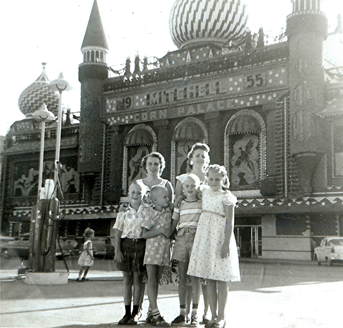 Marge, Carol, Johnny, Billy, Tommy and Peggy posing in front of the Mitchell Corn Palace, 1950s