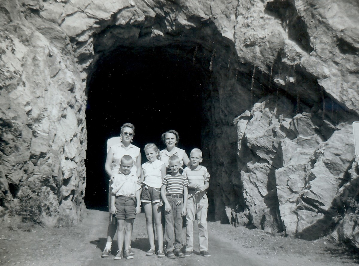 """One of the tunnels through rock on scenic route # 85A - Carol, Marge, Johnny, Billy & Tommy"