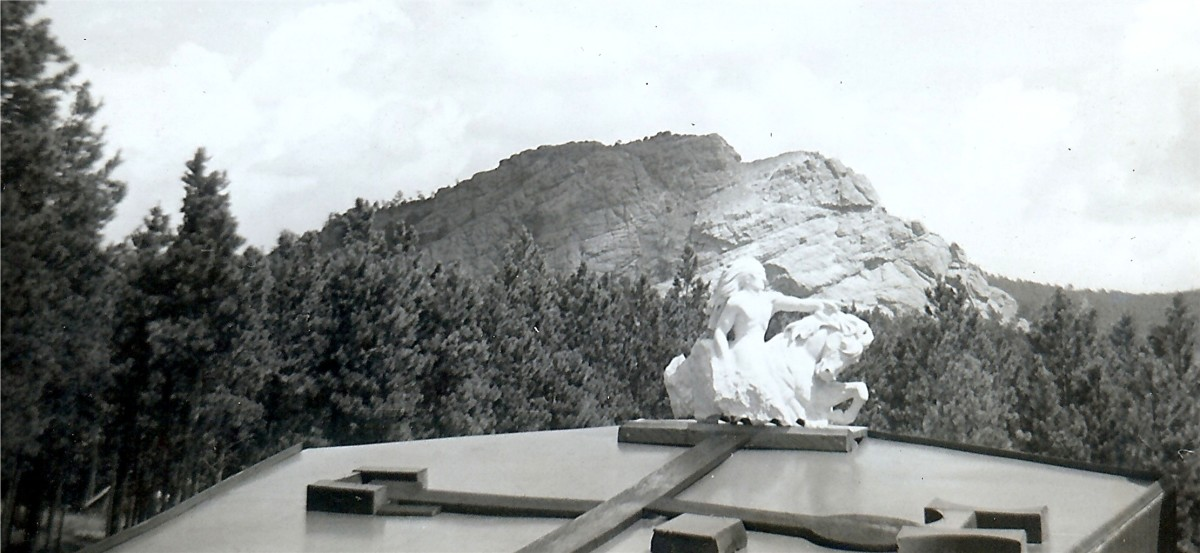 """You can see in the background on the mountain where they have cut out quite a bit with air hammers."" (Chief Crazy Horse Memorial, 1950s Photo)"