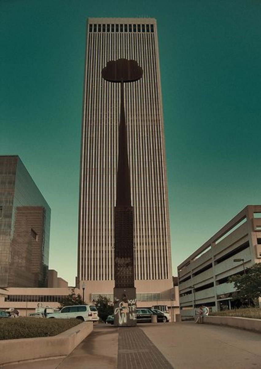 Downtown Tulsa Treasures: The Artificial Cloud is dwarfed by downtown Tulsa's tallest skyscraper, the BOK Tower. The Bank of Oklahoma Tower is a much smaller version of one of the twin towers of NYC's World Trade Center, and was actually designed by