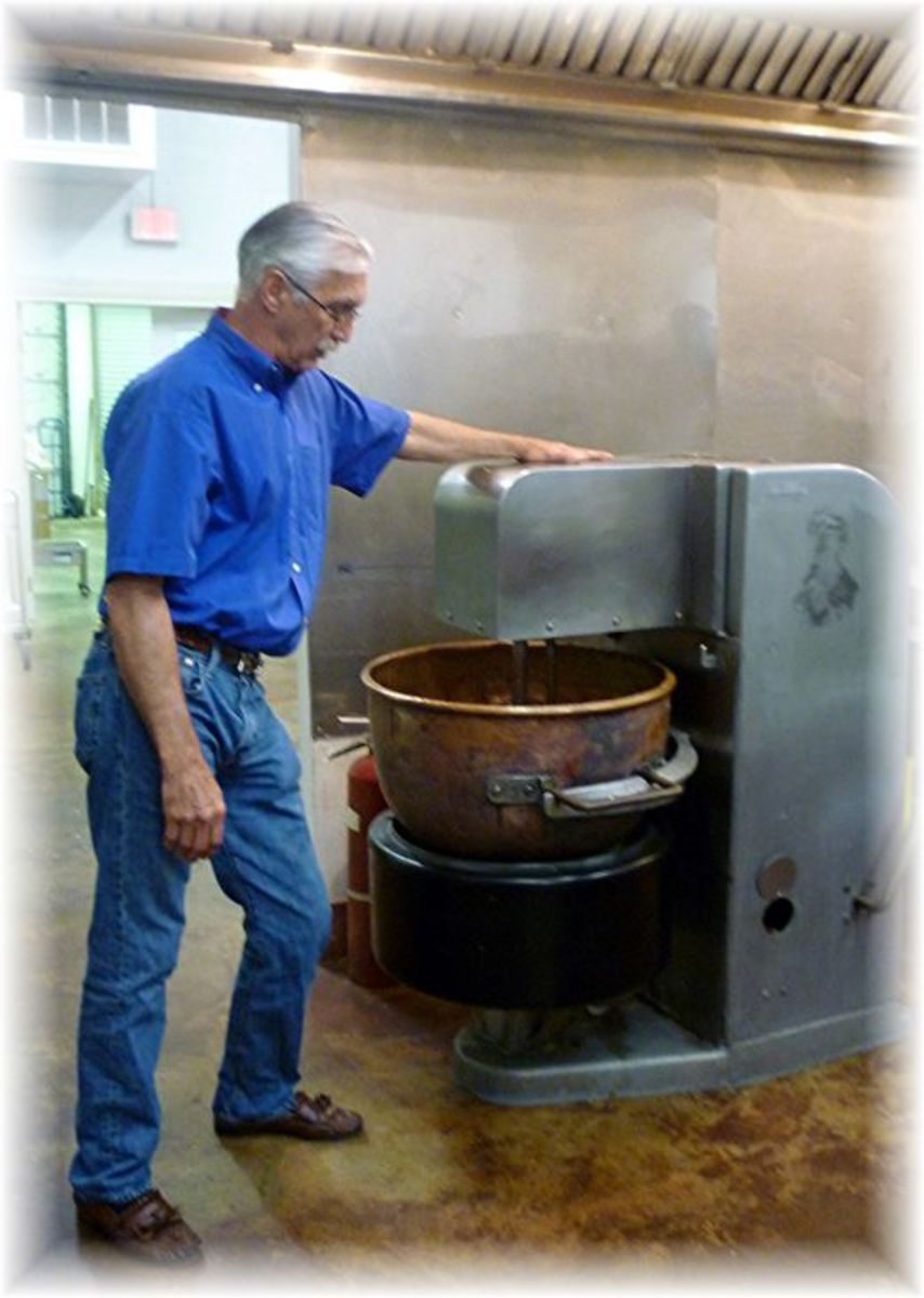 Kenneth Wilkinson explaining how sugar is melted in this large copper pot...part of the truffle making process.