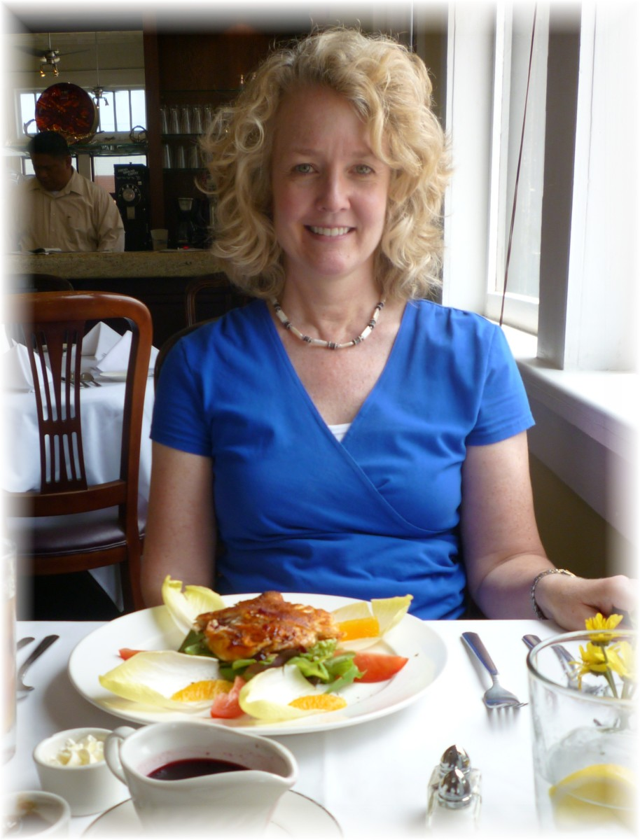 Lisa enjoying her salad with chicken and goat cheese inside Cocoamoda Restaurant in Calvert, Texas.