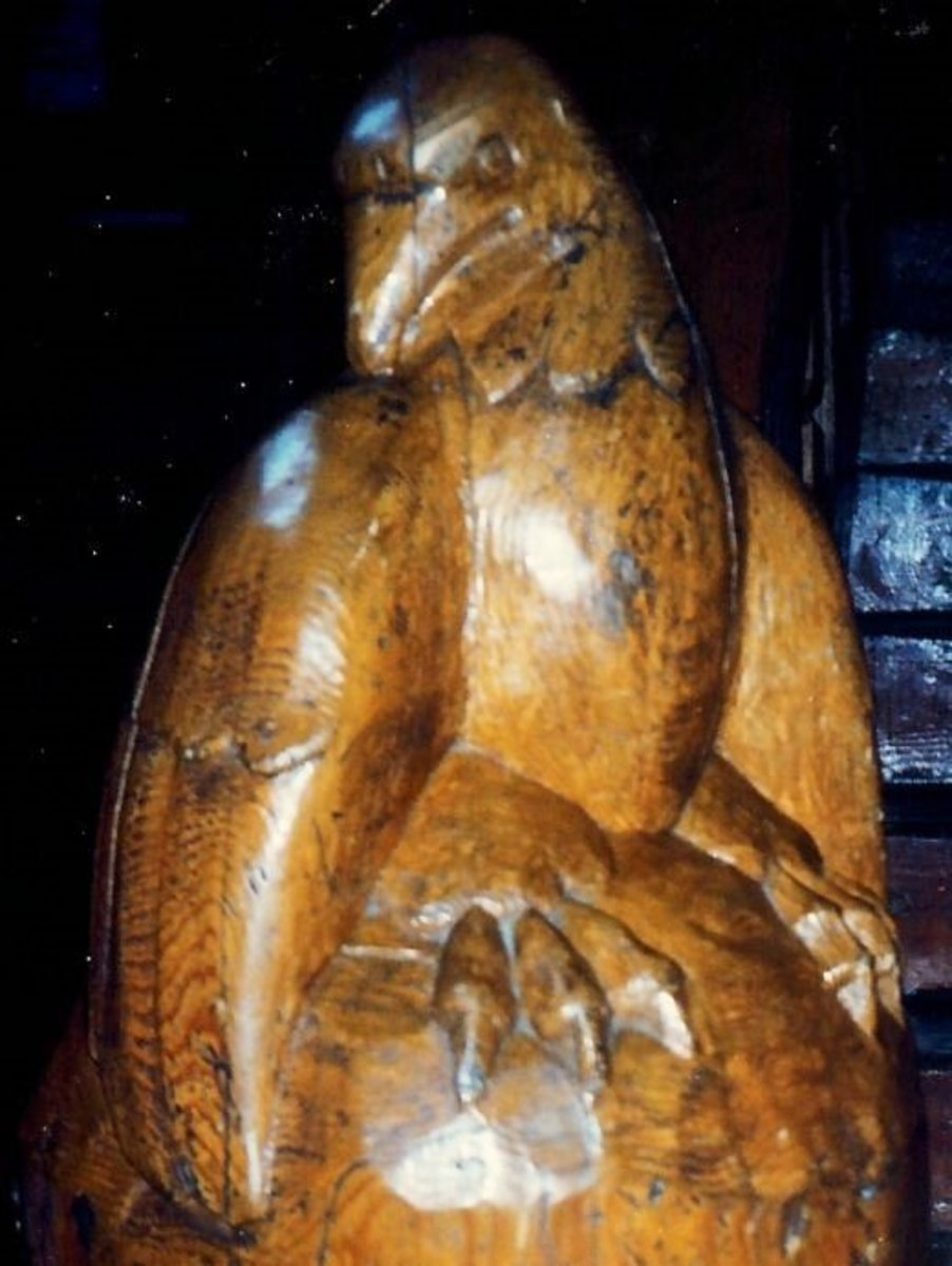 Hand carved bird motif at the end of the banister